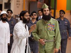 Sacha Baron Cohen, right, and Jason Mantzoukas star in 'The Dictator,' which showcases Cohen's trademark outlandish humor, but also features moments of clever satire.