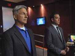 CBS' 'NCIS,' starring Mark Harmon, left, and Michael Weatherly, kept a firm grip on No. 1 with 18.2 million viewers last week.