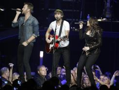 Lady Antebellum's Charles Kelly, Dave Haywood and Hillary Scott perform Wednesday in Louisville.