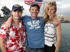 Director Pete Berg, center, hangs out with stars Taylor Kitsch and Brooklyn Decker in Honolulu. The three hope to defy the negative expectations that have been built around the film 'Battleship.'