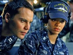 Taylor Kitsch and Rihanna headline a cast of young stars (and pop stars) in 'Battleship' but can't save this cliche-ridden fare.