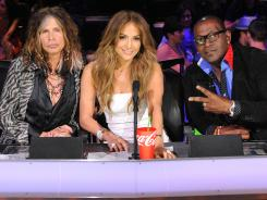 Steven Tyler, left, Jennifer Lopez and Randy Jackson hold court from the judges' table on the set of 'American Idol.'