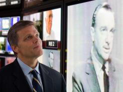 And that's the way it is: Historian Douglas Brinkley in front of an image of Walter Cronkite at CBS studios in New York. His biography, 'Cronkite,' arrives Tuesday.