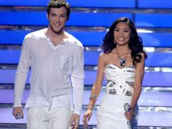 Phillip Phillips and Jessica Sanchez wear white during the American Idol finale in Los Angeles. Phillips will receive the same $300,000 advance given to last year's winner, Scotty McCreery, upon completion of his first album, according to the contracts.