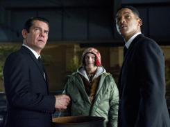 Josh Brolin, left, Michael Stulbarg and Will Smith star in 'Men in Black 3.'