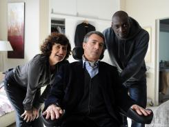 Anne Le, left, Francois Cluzet and Omar Sy are navigating race and class in France.