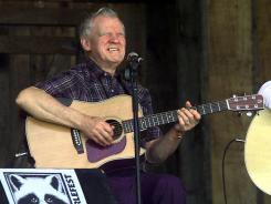 Music legend Doc Watson performs at the annual Merlefest in Wilkesboro, N.C., in 2001.