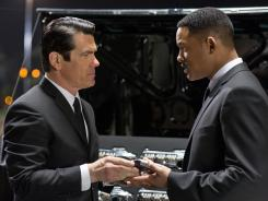 "Josh Brolin, left, and Will Smith star in ""Men in Black 3,"" which grabbed the top box office spot from ""The Avengers"" this week."