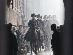 Leading the musical charge: Oscar winner Russell Crowe keeps the officers in line as Javert, who works relentlessly for years to capture Jean Valjean in 'Les Miserables.'