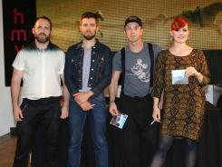 Babydaddy, left, Del Marquis, Jake Shears and Ana Matronic of Scissor Sisters sign copies of their new album, 'Magic Hour,' at a HMV store in London.