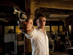 More ammo for rising career: 'Cosmopolis' casts Robert Pattinson as a banker whose empire is crashing.