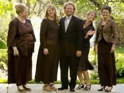 In this undated photo provided by TLC, Kody Brown, center, poses with his wives, from left, Janelle, Christine, Meri, and Robyn in a promotional photo for Sister Wives.