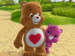 Tenderheart Bear and little Wonderheart Bear share a moment in the new Care Bears: Welcome to Care-a-Lot animated series.