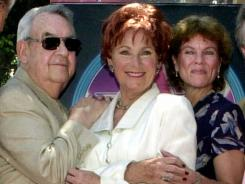 Actors Tom Bosley, Marion Ross and Erin Moran of the TV show 'Happy Days,' pose after Ross received a star on the Hollywood Walk of Fame in 2001.