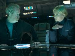 "Ridley Scott with Charlize Theron on the set of 'Prometheus.' Scott is coy about whether the film is a prequel to his sci-fi/horror classic 'Alien.' ""It's a prequel to myself,"" Scott says."