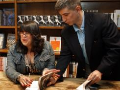 EL James signs copies of 'Fifty Shades of Grey,' which topped the list again in May.