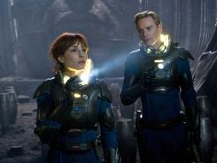 Journey of discovery: Noomi Rapace and Michael Fassbender seek humanity's origins on a distant planet.