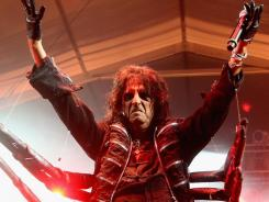 A leggy Alice Cooper performs The Black Widow. His Frankenstein featured a monster.