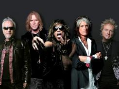 Aerosmith, from left, Brad Whitford, Tom Hamilton, Steven Tyler, Joe Perry and Joey Kramer, kicks off its Global Warming tour Saturday in Minneapolis.