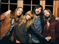 Grace Potter and the Nocturnals' (Matt Burr, left, Grace Potter, Scott Tournet, Benny Yurco) new album, 'The Lion The Beast The Beat' offers earnest and polished tunes. We recommend downloading 'Never Go Back' and 'Timekeeper.'
