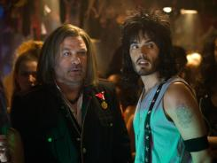 "Lip locked: Alec Baldwin, left, and Russell Brand share a smooch in the upcoming rock musical Rock of Ages. ""When I kissed Russell, I had to stop myself from crying, actually. Because I was so in love with him,"" Baldwin says."