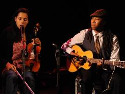 Rhiannon Giddens, left, and Hubbie Jenkins of the Carolina Chocolate Drops play traditional string band music with a twist.