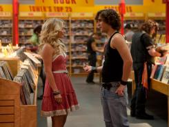 Sherrie Christian (Julianne Hough), left, and Drew Boley (Diego Boneta) shop at Tower Records, one of the many iconic Sunset Strip locations re-created in 'Rock of Ages.'