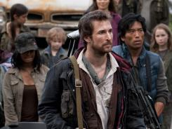 Noah Wyle, center, portrays Tom Mason, who is second-in-command of a ragtag regiment of survivors in the ravaged Boston area.