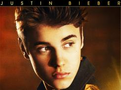 "Justin Bieber's new album 'Believe' is out Tuesday. ""I took nearly eight months to record this album, now it's back to the grind, which I enjoy,"" says Bieber."
