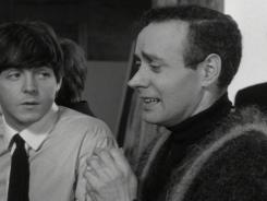 Actor Victor Spinetti, pictured on set of a Beatles film (Paul McCartney is to his left), died from cancer at age 82.