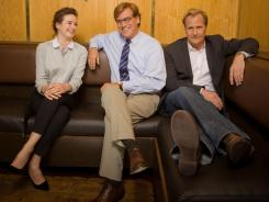 "Writer Aaron Sorkin, surrounded by actors Emily Mortimer and Jeff Daniels, says his new show 'The Newsroom' is ""an extremely idealistic, romantic, optimistic take on television and the news business."" The HBO series premieres Sunday."