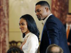 Jada Pinkett Smith and her husband, Will Smith, attend a State Department ceremony releasing the 2012 Trafficking in Persons Report in Washington on Tuesday.