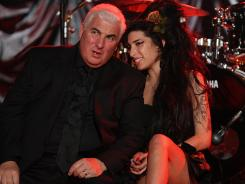 Mitch Winehouse, with his daughter Amy in 2008, airs his frustration, grief and anger over Amy's death last July from accidental alcohol poisoning in a new book, 'Amy, My Daughter.'