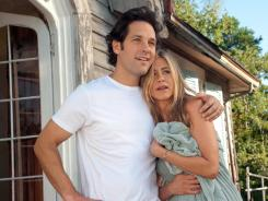 "George (PAUL RUDD) and Linda (JENNIFER ANISTON) in a scene from the motion picture ""Wanderlust."" Photo by Gemma La Mana, Universal Studios [Via MerlinFTP Drop]"