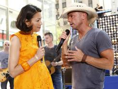 Embattled 'Today' host Ann Curry kept things business as usual Friday morning, introducing musical guest Kenny Chesney.