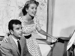 This Sept. 8, 1961 file photo shows Broadway composer Richard Adler and his wife actress-singer Sally Ann Howes in New York.