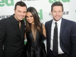 Seth MacFarlane, left, Mila Kunis and Mark Wahlberg arrive for the premiere of Ted at Grauman's Chinese Theater in Hollywood.