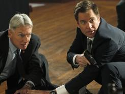 'NCIS' investigates the death of an agent, with Gibbs (Mark Harmon, left) helping Tony (Michael Weatherly) try to figure out what happened.