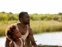 First-time actors Quvenzhane Wallis, front, and Dwight Henry offer stellar performances and add to the magic quality of the modern fairy tale 'Beasts of the Southern Wild.'