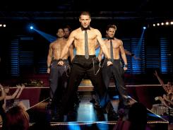 Adam Rodriguez, left, Kevin Nash, Channing Tatum and Matt Bomer explore the world of male stripping, from the stage and beyond, in director Steven Soderbergh's 'Magic Mike.'