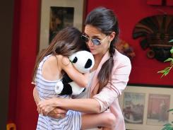 Snuggled up: A Tom Cruise-less Katie Holmes and Suri have been seen out and about numerous times this spring and summer. Paps caught them in New York on June 14.