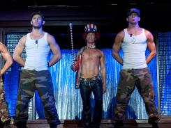 The stars of 'Magic Mike,' Alex Pettyfer, left, Matthew McConaughey and Channing Tatum, have a theory to test. &quot;The power of women in films often comes from their sexuality,&quot; says producer and star Tatum. &quot;We wanted to have men draw their power that way to reflect how things are changing in society.&quot;