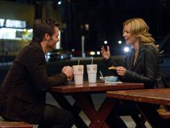 Premises like this: 'People Like Us,' starring Chris Pine, left, and Elizabeth Banks, undermines its own believability with a heavy-handed and melodramatic nature.