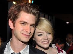Andrew Garfield and Emma Stone walked the red carpet separately for the premiere of 'The Amazing Spider-Man' on Thursday.