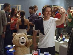 Crass and cuddy: John (Mark Wahlberg) and his foul-mouthed teddy bear (voiced by Seth MacFarlane) toast friendship and maturity.