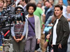 Tom Cruise is pictured on the set of his next film 'Oblivion' on June 12. His wife, Katie Holmes, filed for divorce June 28.