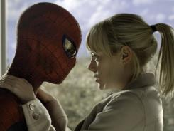 His identity is hidden, but Spidey (Andrew Garfield) doesn't hide his love for Gwen (Emma Stone).