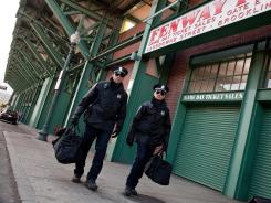 Ben Affleck, left, and Jeremy Renner play robbers with their eyes on Fenway Park in 'The Town.'