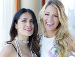 Savage beauties: Salma Hayek, left, and Blake Lively clean up nicely after a gritty turn in Oliver Stone's 'Savages,' out Friday.