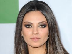 Mila Kunis, who can be seen in theaters now in 'Ted,' sports a memorable Robindira Unsworth pendant in the film.